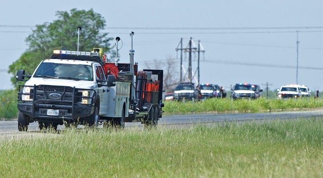 Emergency responders gather at the scene of a traffic collision on northbound U.S. Highway 67 north of San Angelo on Thursday, July 29, 2021.