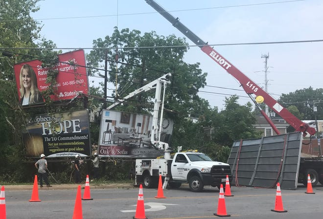 These signs along Greenville Avenue were damaged Tuesday night.