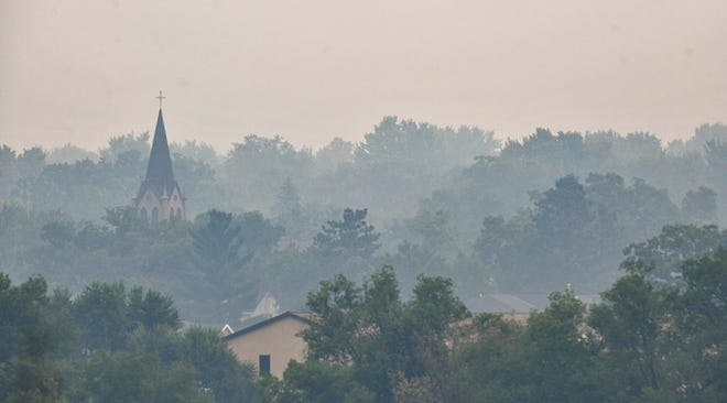 Smoke from Canadian wildfires is visible near the Harvest Fellowship Church Thursday, July 29, 2021, in Sauk Rapids.