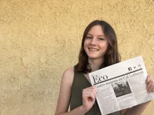 Former El Eco journalist Hannah Sanders with an issue of the Spanish-language student newspaper at California Lutheran University.