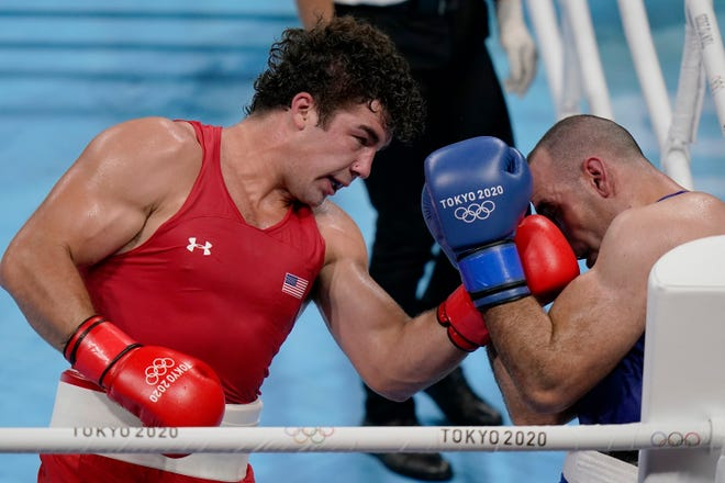 Tulare's Richard Torrez Jr. from the United States, left, punches Algeria's Chouaib Bouloudinats during their men's super heavyweight over 91-kg boxing match at the 2020 Summer Olympics, Thursday, July 29, 2021, in Tokyo, Japan. (AP Photo/Frank Franklin II)
