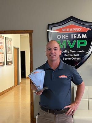 Wichita Falls SERVPRO franchise co-owner Aaron Ryan is seen with his bronze level chairman's award from the company for top performance.