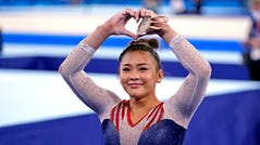 Sunisa Lee reacts in the women's individual all-around final on Thursday.
