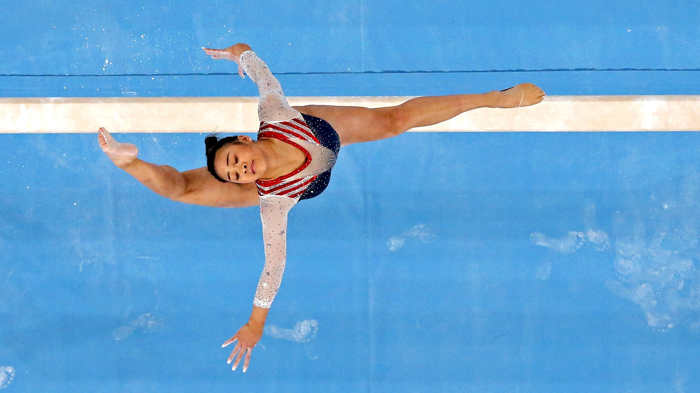 Suni Lee continues US gymnastics dynasty with all-around gold: How she won in photos
