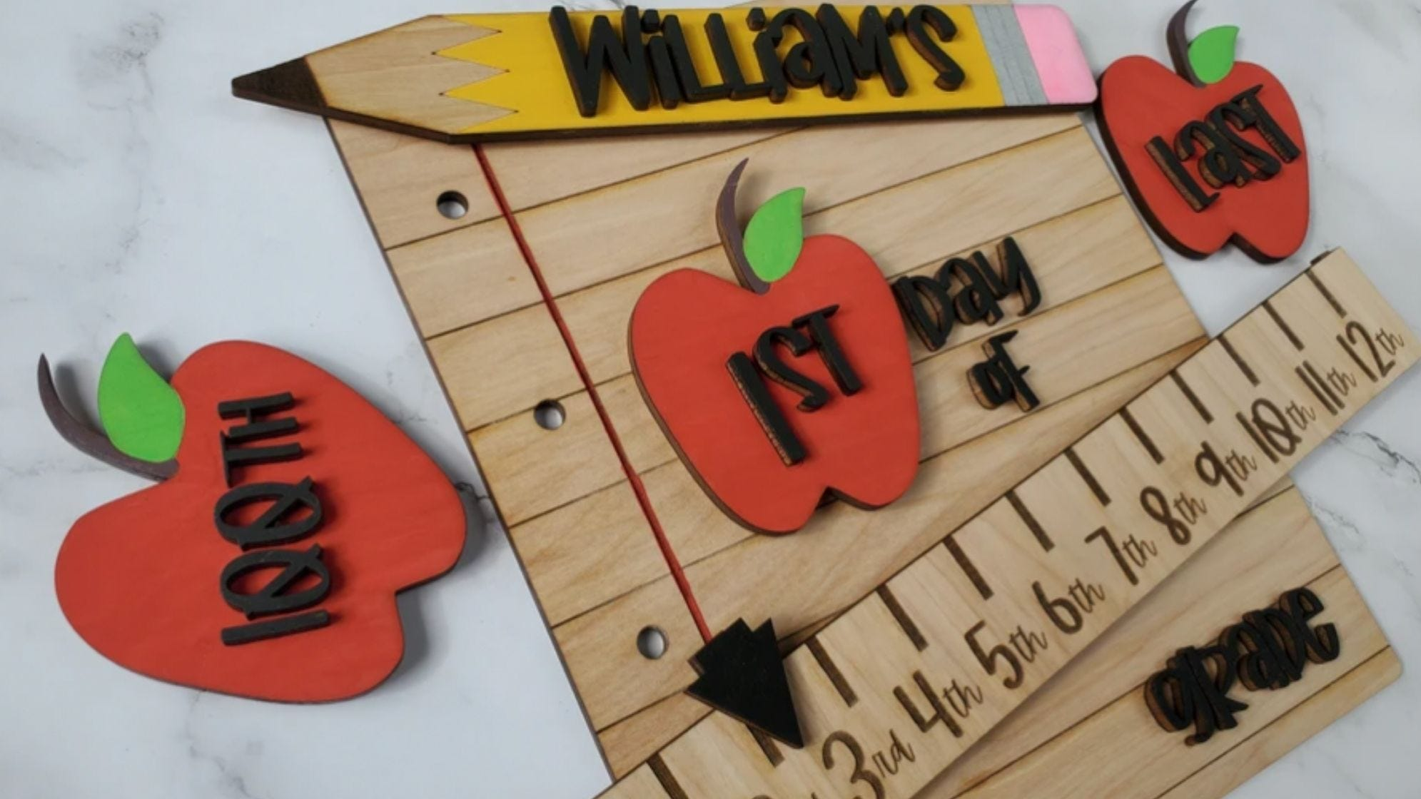 Apples, a ruler, and a pencil hit on all the first day iconography.
