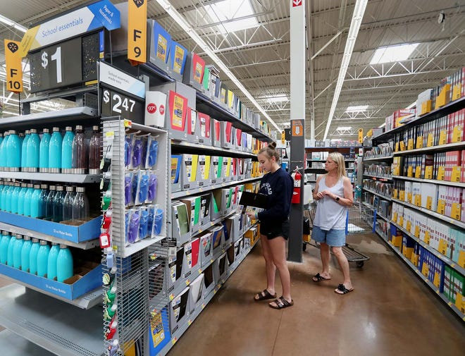 Lexie Clements, 18, left, and her aunt, Cathi Dalton, both of Tallmadge, shop for school supplies for Clements who will be a freshman at Cedarville University at Walmart in Brimfield Township on Friday.