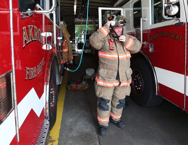 """Lt. Greg Galehouse, at Akron Fire Department Station 8, said a comprehensive physical exam for firefighters """"basically saved my life."""""""