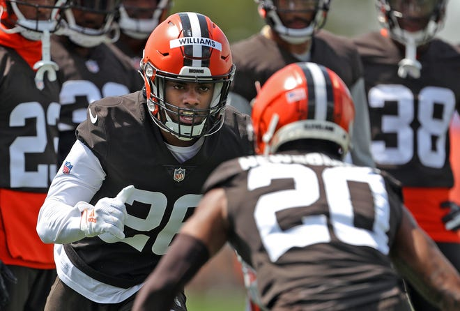 Cleveland Browns cornerback Greedy Williams, facing, participates in drills with Greg Newsome II during NFL football training camp, Friday, July 30, 2021, in Berea, Ohio.
