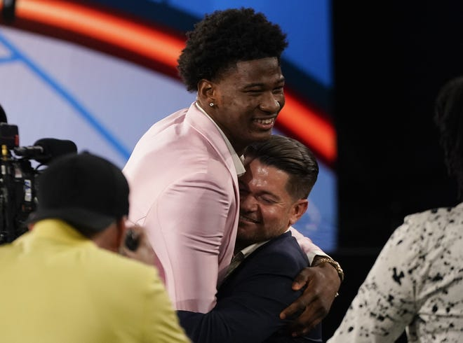 Texas' Kai Jones shows his joy after being selected 19th overall in Thursday night's NBA draft. Fellow Longhorns Greg Brown III and Jericho Sims also were taken, making it the first time since 2011 that UT had three players drafted in the same year.