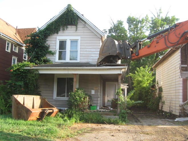 This condemned home at 371 W. Main St. in Alliance was razed Friday as part of a project that used Community Development Block Grant funding to clear problem properties.