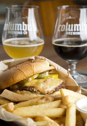 A cheeseburger and fries with a beer flight at the Columbus Brewing Co.