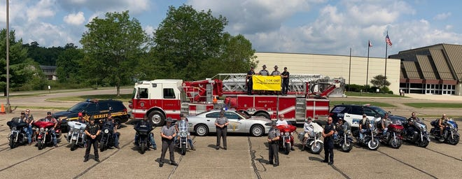 """The State Highway Patrol and more than a dozen motorcycle riders joined forces with the Cambridge Police and Fire departments and the Guernsey County Sheriff's Office to raise motorcycle safety awareness. Motorists are reminded to """"Look Out for Motorcycles"""" as part of a campaigned aimed at reducing fatal and injury accidents involving motorcycle riders."""