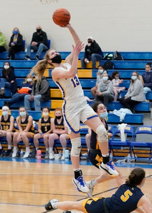 Madison's Carly Anschuetz goes up for a layup during a game in the 2021 season. [Telegram photo by Mike Dickie]