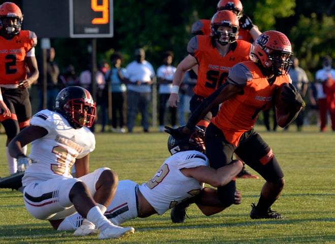 North Davidson's Jamarien Dalton tries to break away from a Salisbury tackler in the spring 2021 NCHSAA 2-AA state semifinals. The NCHSAA's existence is in jeopardy due to legislation moving through the North Carolina General Assembly. [Mike Duprez/The Dispatch]
