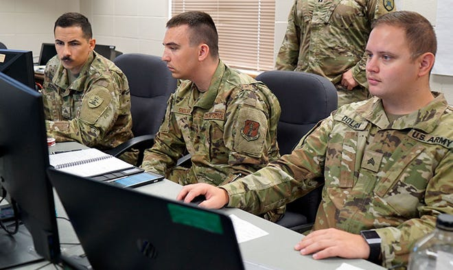North Dakota National Guard members participate in Cyber Shield 2021 at Camp Grafton Training Center, July 21, 2021. From left Sgt. Anthony Koistinen, Joint Force Headquarters, North Dakota National Guard; Staff Sgt. Samuel Sindelar, 119th Wing; and Sgt. Travis Dolan Joint Force Headquarters. Cyber Shield 2021 brought together more than 750 of the nation's top cyber defense professionals from National Guard, along with various governmental, nongovernmental and industry partners in a hybrid in-person and online environment.