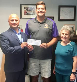 The Wayne Area Sports Hall of Fame board recently awarded a $500 grant to the Forest City Youth Soccer League. Board members Greg Frigoletto (left) and Cathy Howell right) presented the check to Jake Erdmann, league president.