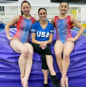 """GAGE gymnasts and U.S. Olympic women's gymnastics team alternates Kara Eaker, left, and Leanne Wong show off the new leotards designed by former GAGE and Olympic gymnast Terin Humphrey, center. Humphrey has her own gymnastics clothing line and looks to add """"gym dad"""" wear soon."""