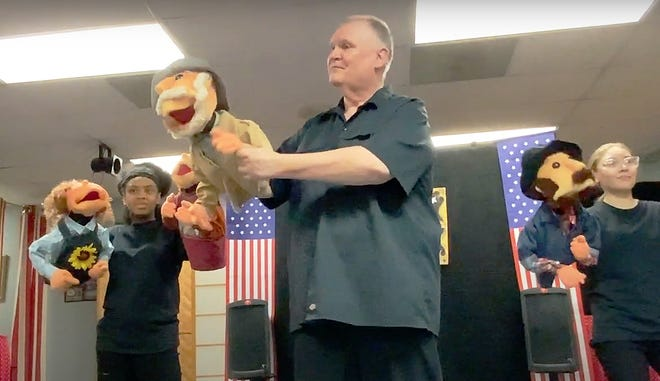 """Puppeteers, from left, Danyell Rucker, Kraig Kensinger and Ava Brown are shown in a preview of Puppetry Arts Institute's """"Missouri Birthday Bash"""" show that will be presented the next two weekends at the National Frontier Trails Museum."""