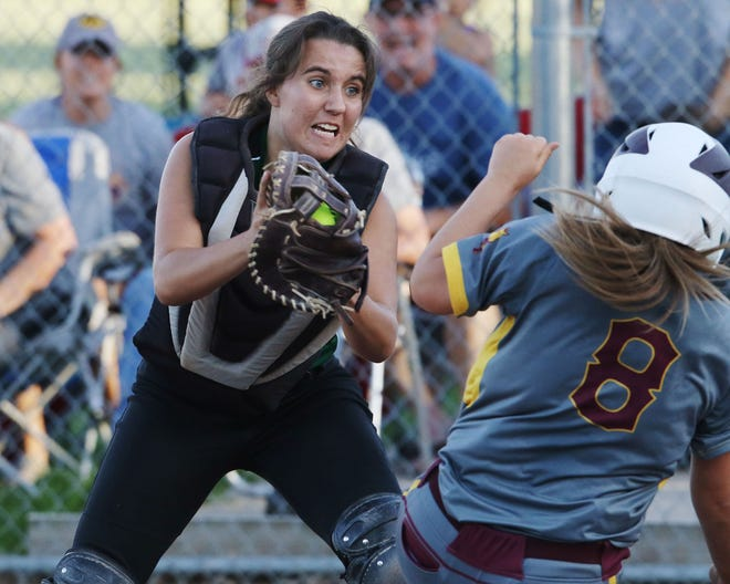 West Burlington-Notre Dames Lexy Davis (8) on her way to tagging out Madison Dunlavy (8) at home during their Class 3A regional quarterfinal against Davis County, Wednesday July 10, 2019 at West Burlington's Barb Carter Field.