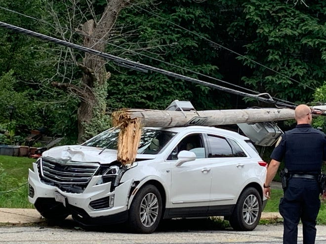 An SUV took down a telephone pole on Elm Street in Gardner on July 30.