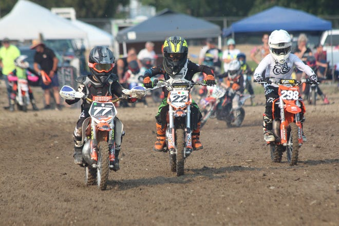 Young riders warm up during the practice time before the SJO Motocross event