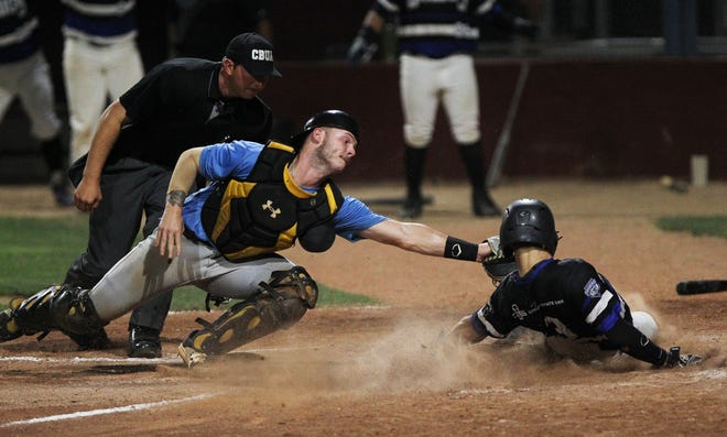 Hutchinson Monarchs' catcher Cooper Harris gets Cheney Diamond Dawgs' Ed Scott (3) out at home plate during their NBC Midwest regional tournament game at Hobart Detter Thursday night. The Monarchs lost to the Dawgs 3-2.