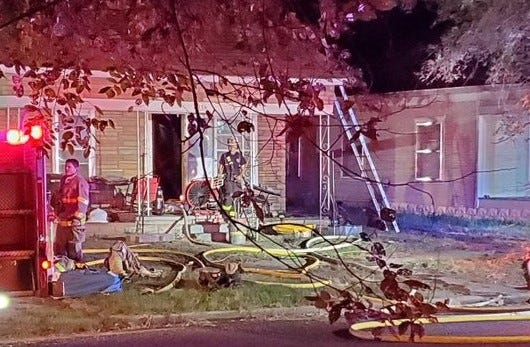 Firefighters responded to a fire at 826 E. Seventh Ave. about 3:40 a.m. Friday. Officials say a dog awoke the residents, alerting them to the fire.