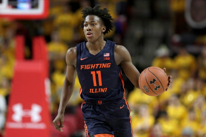 Illinois guard Ayo Dosunmu dribbles up court against Maryland during the first half of an NCAA college basketball game, Saturday, Dec. 7, 2019, in College Park, Md. (AP Photo/Julio Cortez)