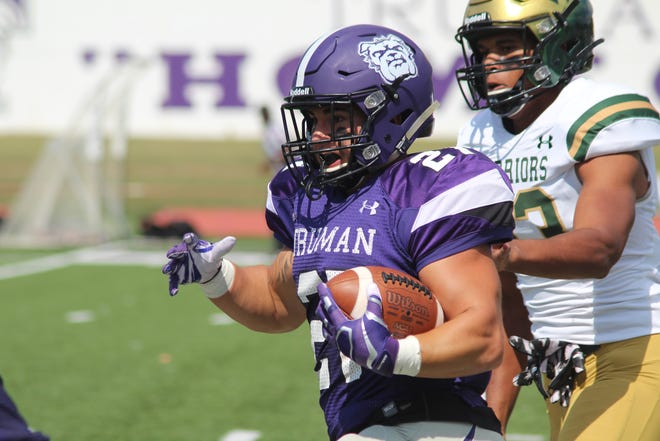 Truman running back Cody Schrader breaks a run during a 2019 game against Wayne State.