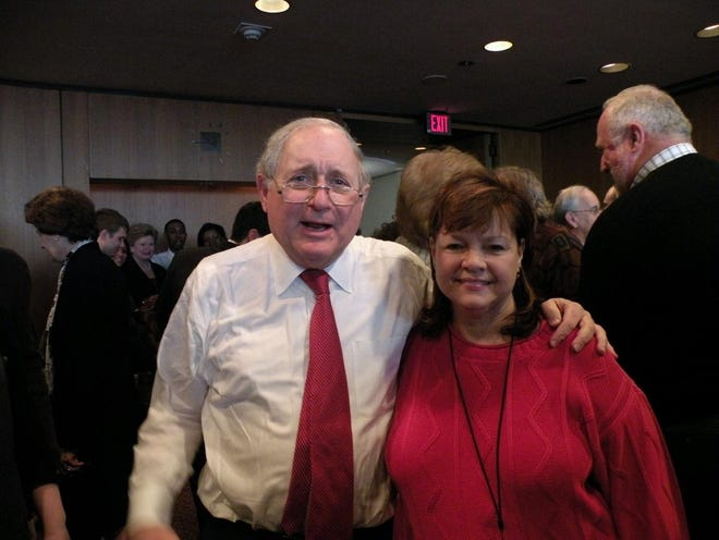 The late U.S. Sen. Carl Levin with Denise Brooks, former Monroe Democratic Party chairperson.