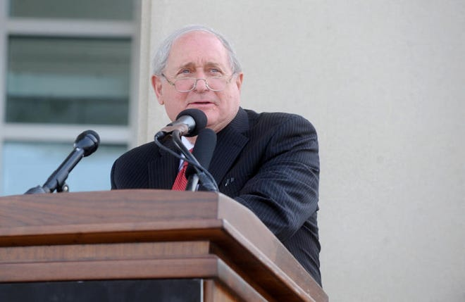 Then-U.S. Sen. Carl Levin, D-Michigan, speaks to an audience during the dedication of the Technology Center at Monroe County Community College in 2013.