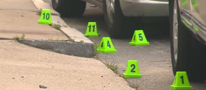 Bullet casings at the scene of a quadruple shooting in Boston. A Braintree man was arrested in connection with the shooting.