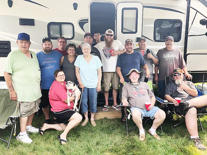 A group of racing enthusiasts from different states gather at a campsite west of the Fairbury Speedway prior to the big Prairie Dirt Classic race.