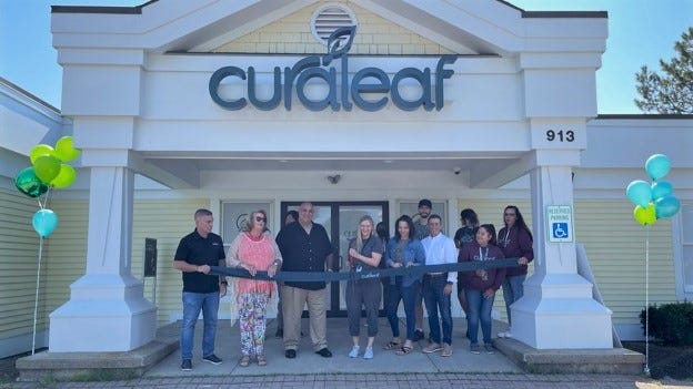 The Curaleaf Maine team celebrates the opening of the company's medical cannabis dispensary in Wells, Maine, on Friday, July 23, 2021.