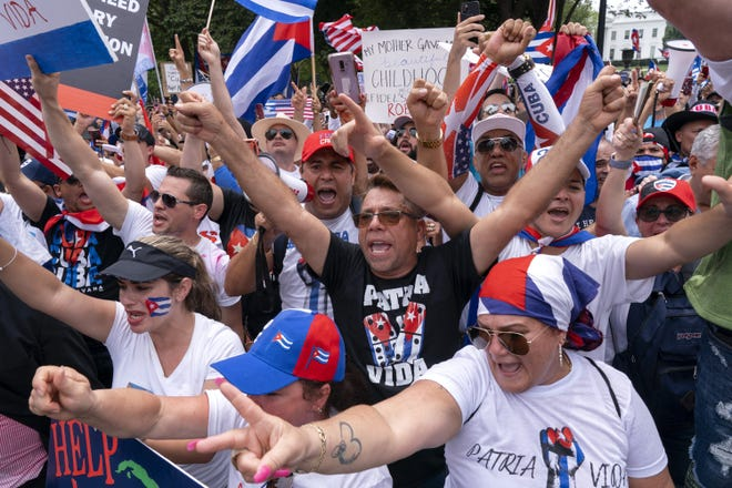 With the White House in the background, hundreds of people, many of Cuban descent, protest the Cuban government, Monday, July 26, 2021, at Lafayette Park in Washington. (AP Photo/Jacquelyn Martin)