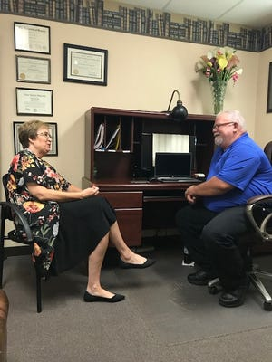 Julie Kramp, executive director of The Center for Counseling & Consultation, pictured left, and Kevin Ford, Mirror Inc. counselor, discuss their new partnership. Mirror is now offering substance-abuse treatment at The Center.