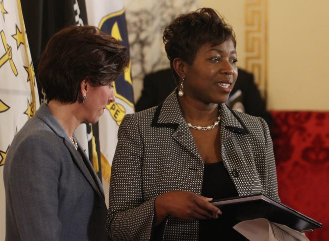 Rhode Island Black Business Association President Lisa Ranglin appears with then-Gov. Gina Raimondo at a State House event in 2016.