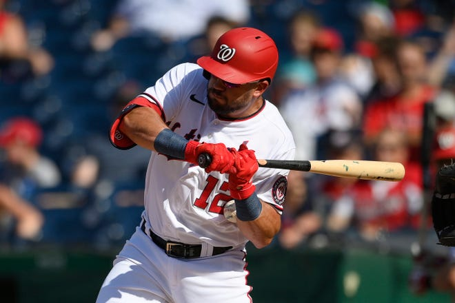 Washington Nationals' Kyle Schwarber gets hit by a pitch during the third inning of a baseball game against the Tampa Bay Rays, Wednesday, June 30, 2021, in Washington. (AP Photo/Nick Wass)