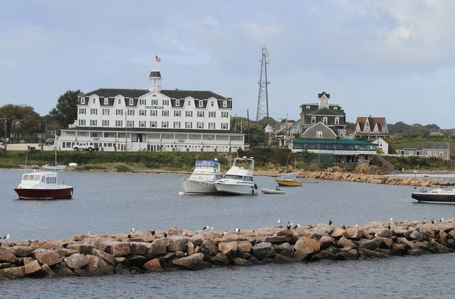 The Surf, right, and National Hotels overlooking Old Harbor on Block Island. The island will now recommend wearing masks in public indoor settings.