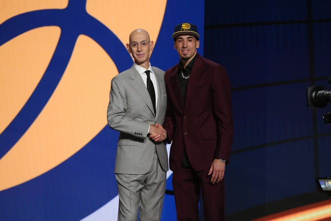 Jul 29, 2021; Brooklyn, New York, USA; Chris Duarte (Oregon) poses with NBA commissioner Adam Silver after being selected as the number thirteen overall pick by the Indiana Pacers in the first round of the 2021 NBA Draft at Barclays Center. Mandatory Credit: Brad Penner-USA TODAY Sports