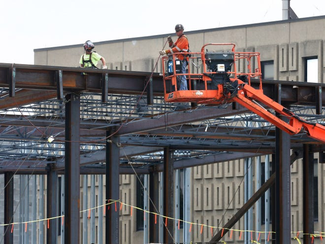Workers continue construction Friday on the Timken Family Cancer Center at Aultman Hospital in Canton.