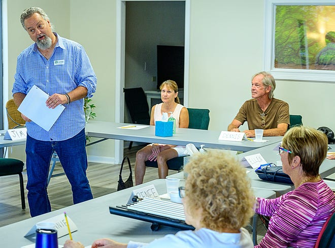 Jim Barber conducts a memory enhancement workshop at his business, which he co-owns with Ginny Bullard, in St. Augustine Beach in July.