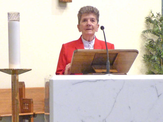 Sister Enda Egan reading scriptures at St. Anastasia Catholic Church.