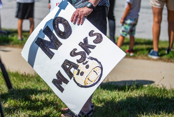 One of the signs at an anti-mask demonstration by Strengthen Our Schools-PHM District on Friday in Mishawaka.