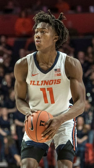 Ayo Dosunmu will continue to call Illinois home after the Chicago Bulls selected the University of Illinois guard and Chicago native on Thursday in the second round of the NBA draft.