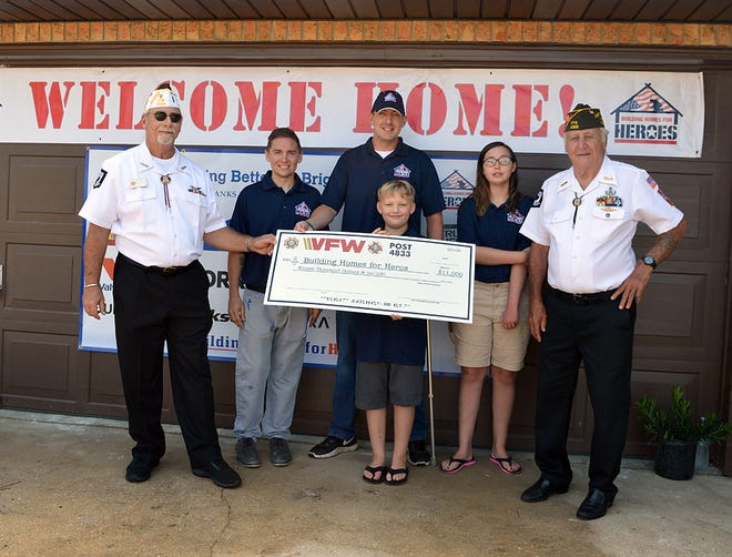 Veterans of Foreign Wars Post 4833 of Milton presented a check to Dan Devine and his family through the Home for Heroes program recently.  The $11,000 will be used to build the Devines a home in Pensacola.