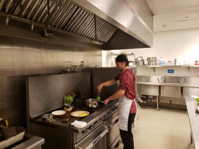A student makes a meal in the Siskiyou County Probation and the Dunsmuir Adult Education program culinary class on Friday (July 30, 2021) in Yreka.