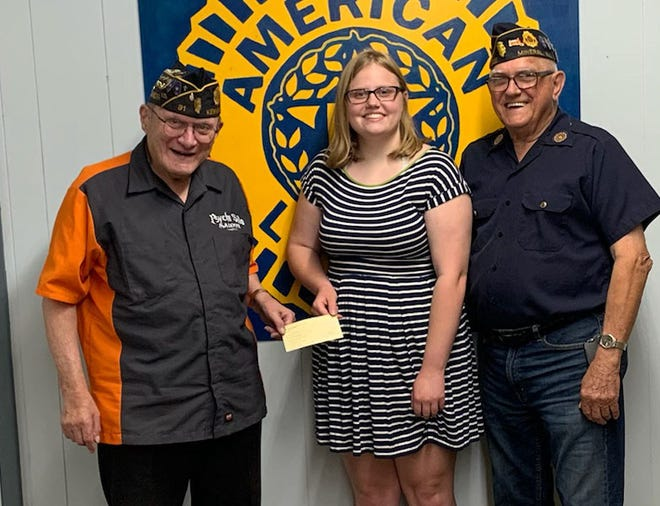 Kewanee American Legion Commander Ted Canellos, flanked by post member Glenn Morey, awards the Roy C. Pettit Scholarship award to Wethersfield High School student Natalie Clark.