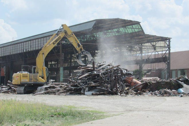 A work crew tears down a building at the former Kewanee Boiler Co. property in 2018.