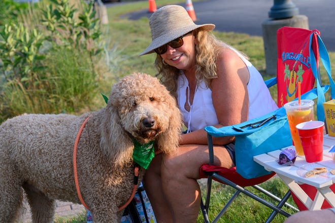 A crowd turned out to hear local duo Knock On Wood at Center Stage in Lakeville last Tuesday night as part of the Lakeville Arts Council's Summer Concert Series. Here, Kerry and her golden doodle pup Doyle enjoy a summer night while listening to some classic songs from the past.